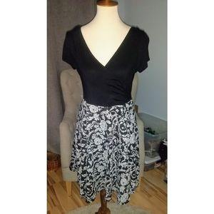 HOLIDAY Black V-neck dress w/ Paisley skirt